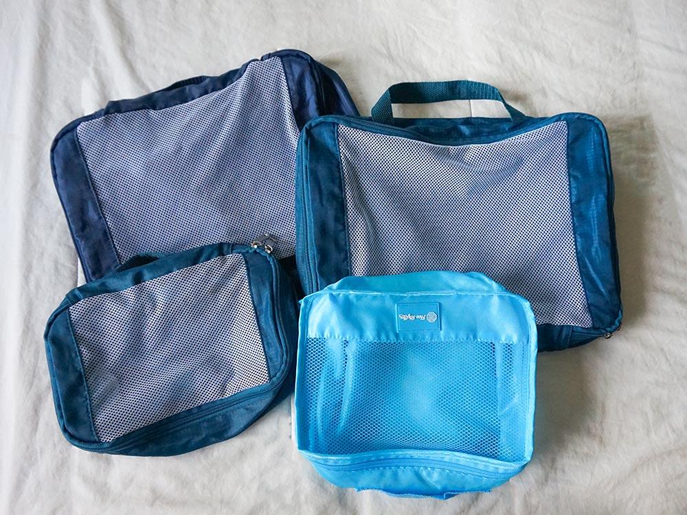 Veja o que são e como usar packing cubes, os melhores organizadores de mala!